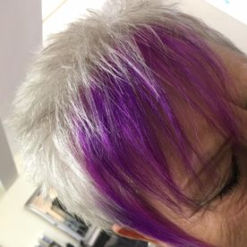 A woman that has had her fringe dyed purple