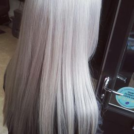 A woman's hair that has been dyed silver by our team
