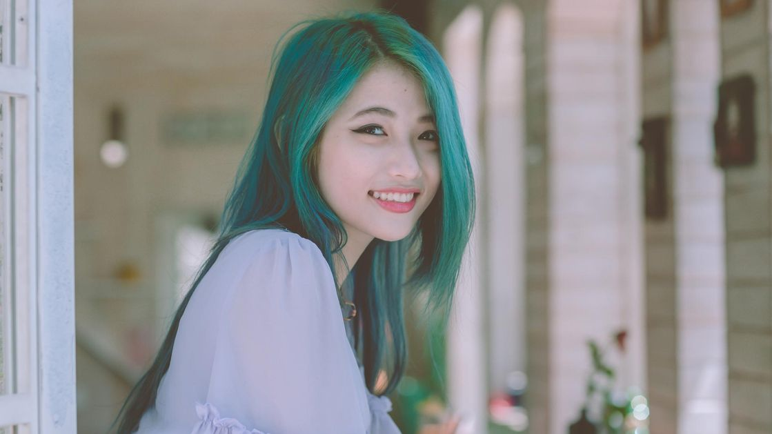 A woman with green dyed hair